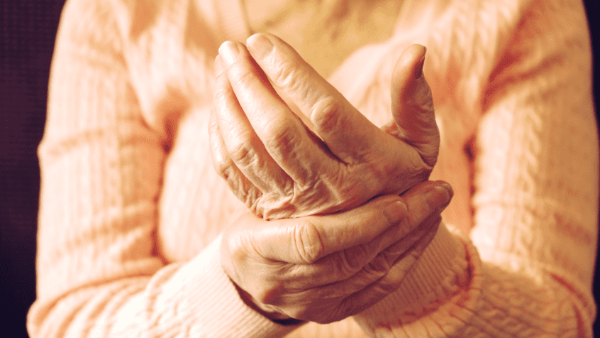 visual image of woman suffering from arthritic pain in her hands